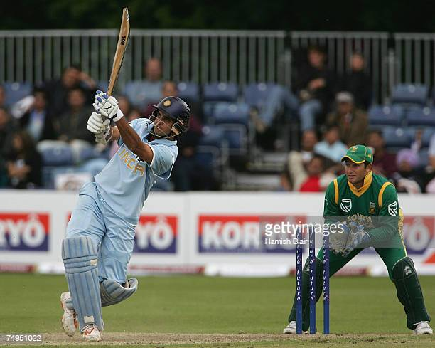 Sourav Ganguly of India hits out with Mark Boucher of South Africa looking on during the second One Day International match between South Africa and...