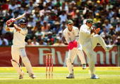 Sourav Ganguly of India square drives as Ricky Ponting jumps out of the way during day two of the First Test match between Australia and India at the...