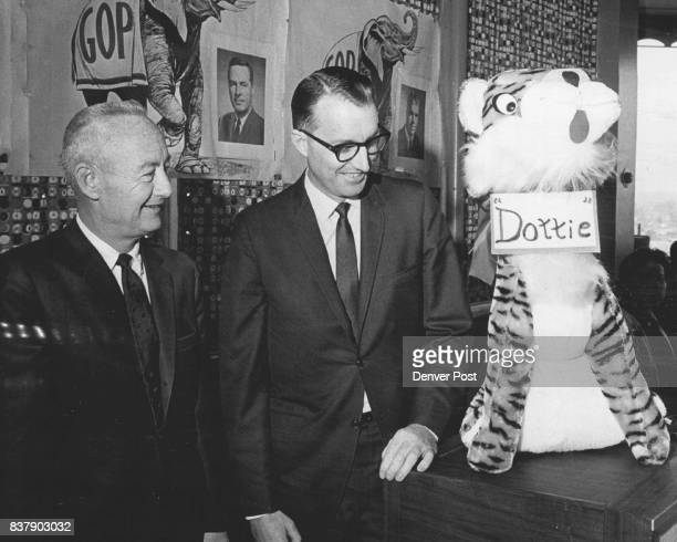 Source of Inspiration Draws Attention Republican leaders Robert E Lee left and Howard Propst admire tiger at meeting of Republican Women's Club Tiger...