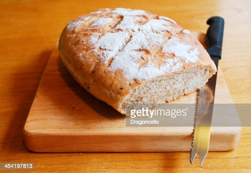 Sourdough on Chopping Board with Knife : Stock Photo