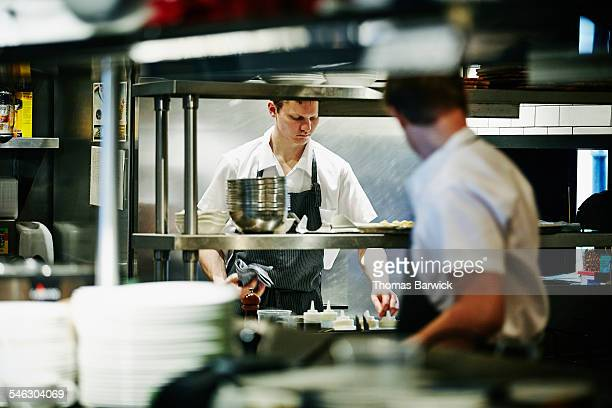 Sous chef preparing ingredients at workstation