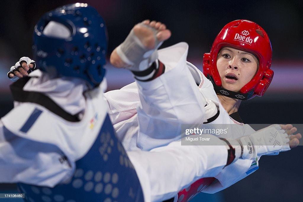 Sousan Hajipourgoli of Iran competes with Dilobar Saydullaeva of Uzbekistan during a women's 57 kg combat of WTF World Taekwondo Championships 2013...