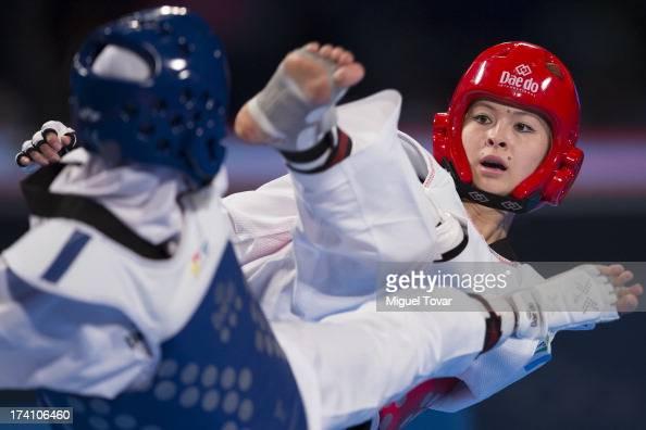 Sousan Hajipourgoli of Iran competes with Dilobar Saydullaeva of Uzbekistan during a women's 57 kg combat of WTF World Taekwondo Championships 2013...