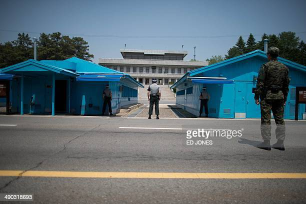 Sout Korean soldiers face the North korean side of the truce village of Panmunjom in the Demilitarized Zone between North and South Korea on May 14...