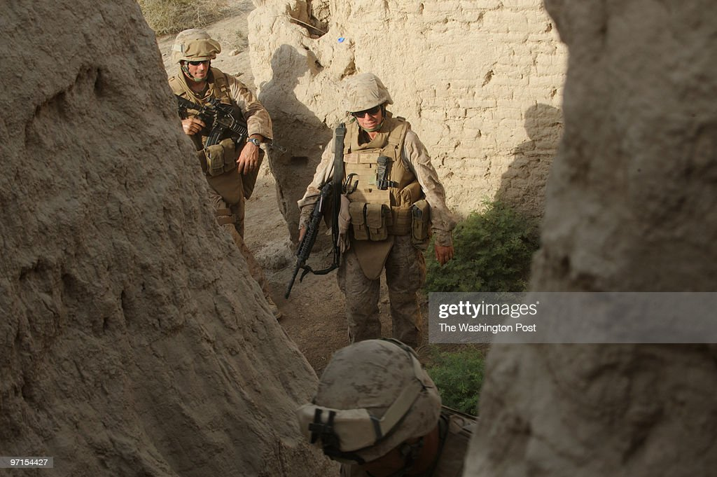 South Afghanistan US Marines get into position as small arms fire erupt near Khan Neshin Afghanistan as part of an expeditionary move into towns and...