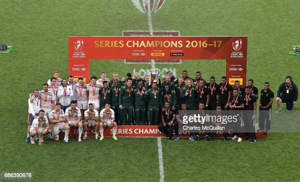 South Africa are presented with the Sevens Series Trophy after the HSBC London Sevens at Twickenham Stadium alonside series runners up England and...