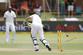 South Africa batsman AB de Villiers is bowled out by West Indies Jerome Taylor during the third day of the second cricket Test match between South...