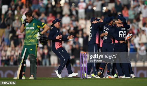 South Africa batsman Chris Morris reacts as England celebrate victory during the 2nd Royal London One Day International between England and South...