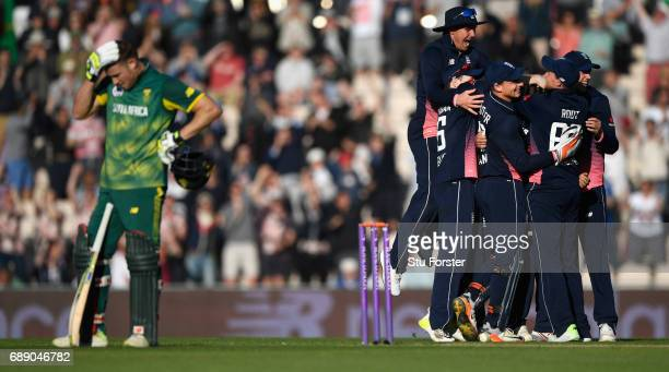 South Africa batsman David Miller reacts as England celebrate victory during the 2nd Royal London One Day International between England and South...