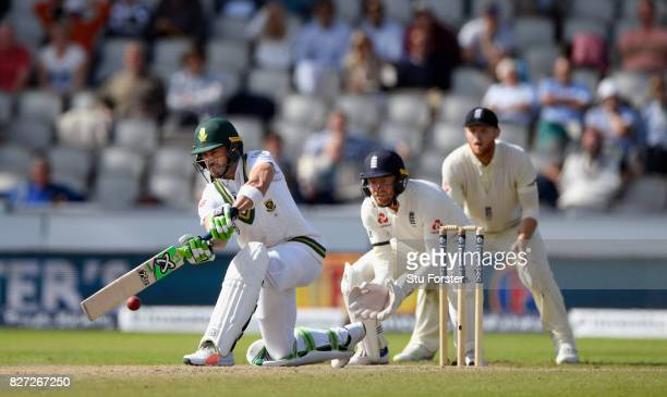 South Africa batsman Faf du Plessis hits out watched by Jonny Bairstow during day four of the 4th Investec Test match between England and South...
