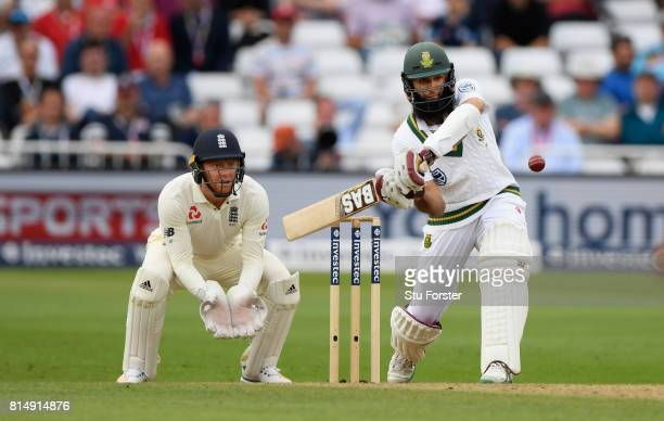South Africa batsman Hashim Amla hits out as Jonny Bairstow looks on during day two of the 2nd Investec Test match between England and South Africa...