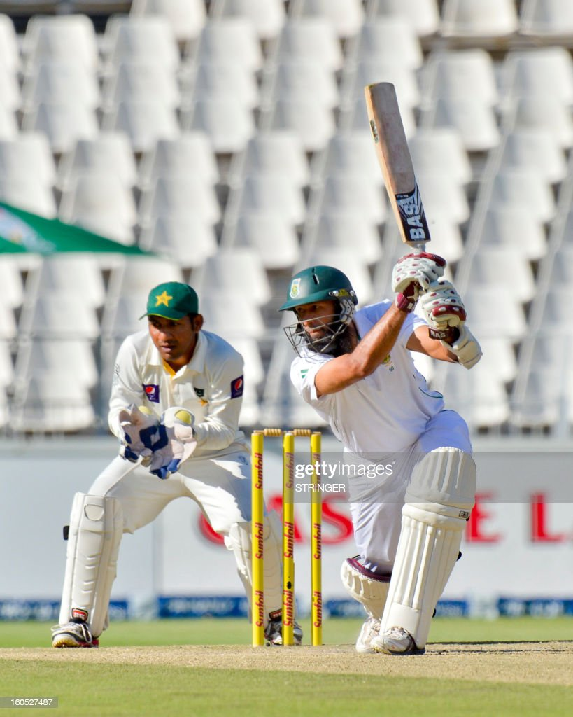 South Africa batsman Hashim Amla, lines up a shot from Pakistan, bowler Saeed Ajmal, on day two of the first Test match between South Africa and Pakistan at Wanderers Stadium in Johannesburg on February 2, 2013.
