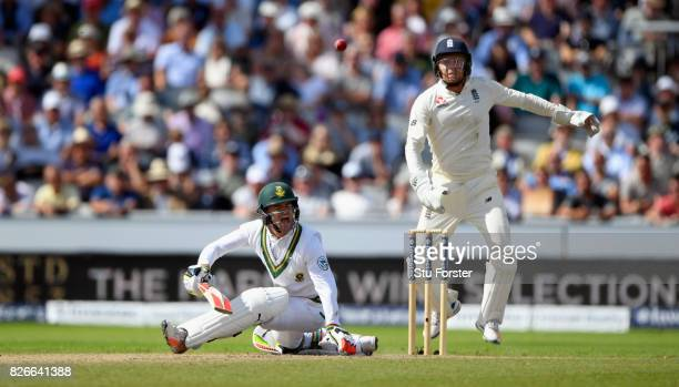 South Africa batsman Heino Kuhn reacts as he goes down in pain as Bairstow looks on during day two of the 4th Investec Test match between England and...