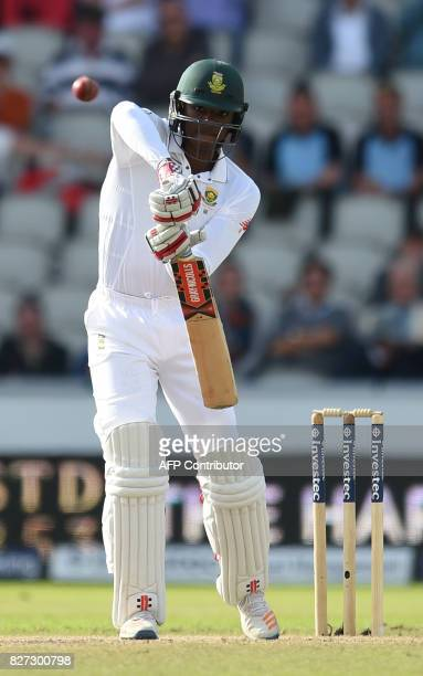 South Africa batsman Kagiso Rabada plays a shot on day 4 of the fourth Test match between England and South Africa at Old Trafford cricket ground in...
