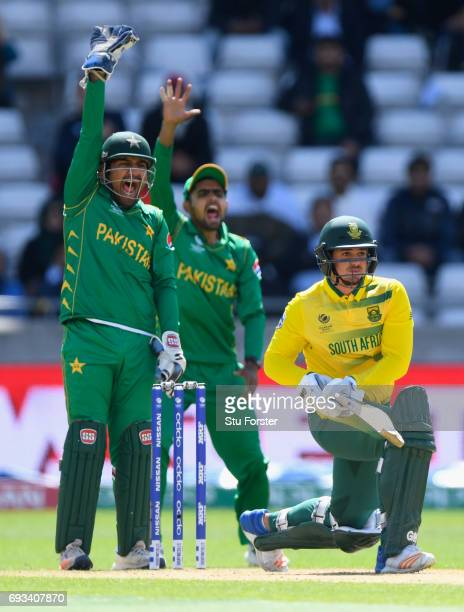 South Africa batsman Quinton de Kock is LBW as wicketkeeper Sarfraz Ahmed appeals during the ICC Champions Trophy match between South Africa and...
