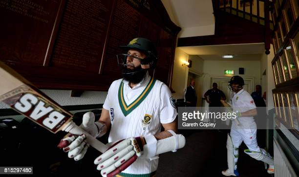 South Africa batsmen Hashim Amla and Dean Elgar walk from the pavilion ahead of day three of the 2nd Investec Test match between England and South...