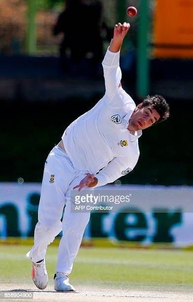 South Africa bowler Duanne Olivier delivers a ball during the third day of the second Test cricket match between South Africa and Bangladesh in...