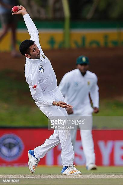 South Africa bowler Keshav Maharaj delivers a ball during the second day of the second Test cricket match between South Africa and Bangladesh in...