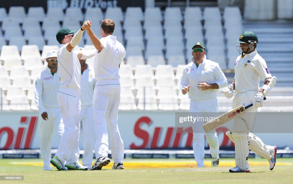 South Africa bowler Morne Morkel celebrates the wicket of Pakistan's Saeed Ajmal with teammate Francois 'Faf' du Plessis on February 4, 2013 on day four of the first Test match against South Africa at Wanderers stadium in Johannesburg.