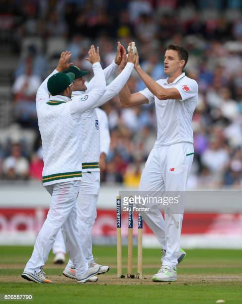 South Africa bowler Morne Morkel is congratulated after bowling Stuart Broad during day two of the 4th Investec Test match between England and South...