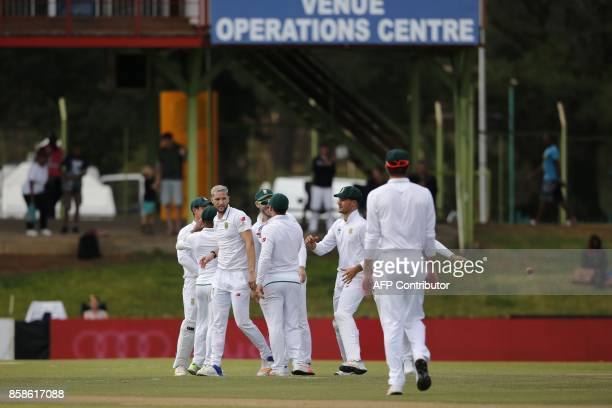 South Africa bowler Wayne Parnell is celebrated after having bowled out Bangladesh batsman Mahmudullah during the second day of the second Test...