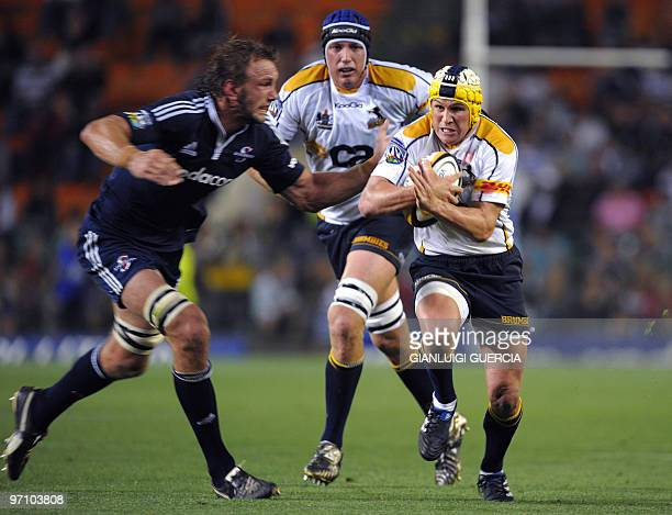 South Africa 'Brumbies flyhalf Matt Giteau breaks through on February 26 2010 during the Super14 rugby match between Stormers and Brumbies at...