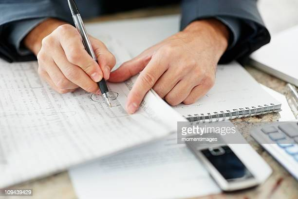 South Africa, Businessman doing paperwork, close-up