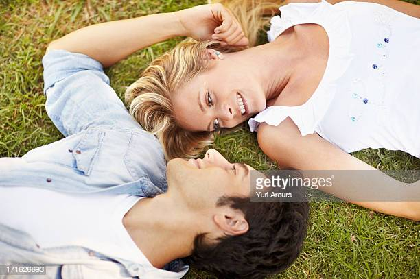 South Africa, Cape Town, Couple lying on grass