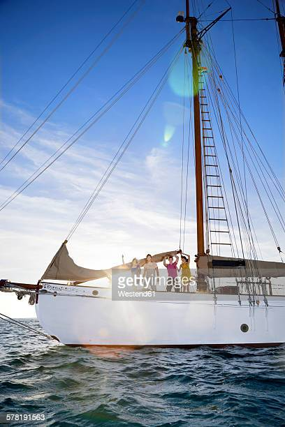 South Africa, Cape Town, friends on a sailing ship on the Atlantic Ocean