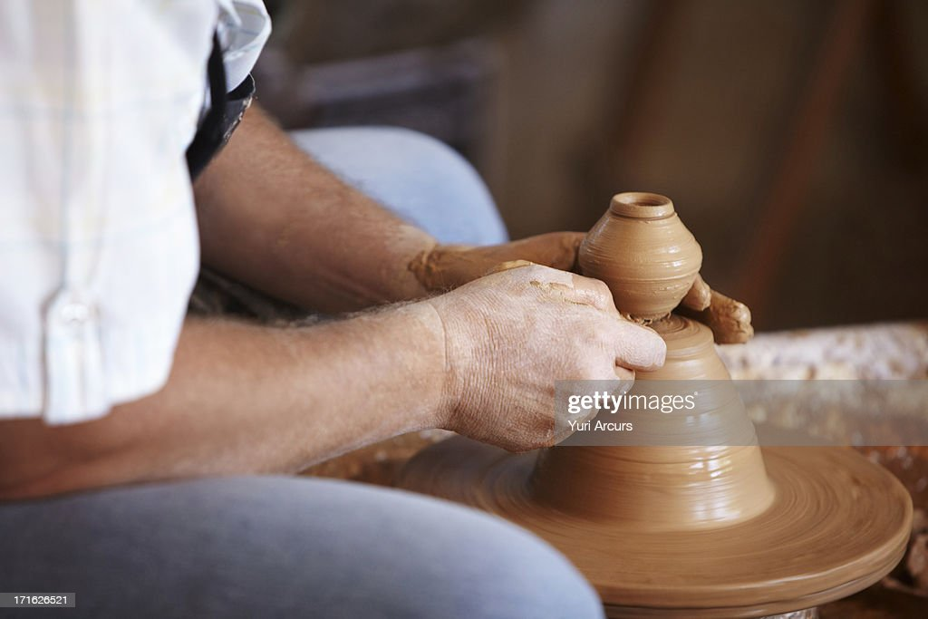 South Africa, Cape Town, Hands working with clay on potter's wheel : Stock Photo