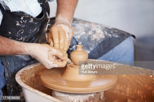 South Africa, Cape Town, Hands working with clay on potter's wheel