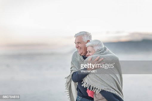 South Africa, Cape Town, happy senior couple on the beach