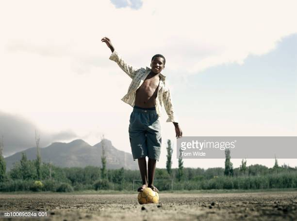 South Africa, Cape Town, Hout Bay, portrait of boy (14-15) balancing on ball
