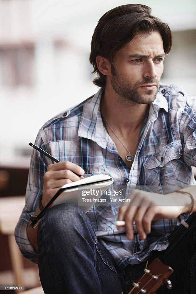 South Africa, Cape Town, Man doing notes : Stock Photo