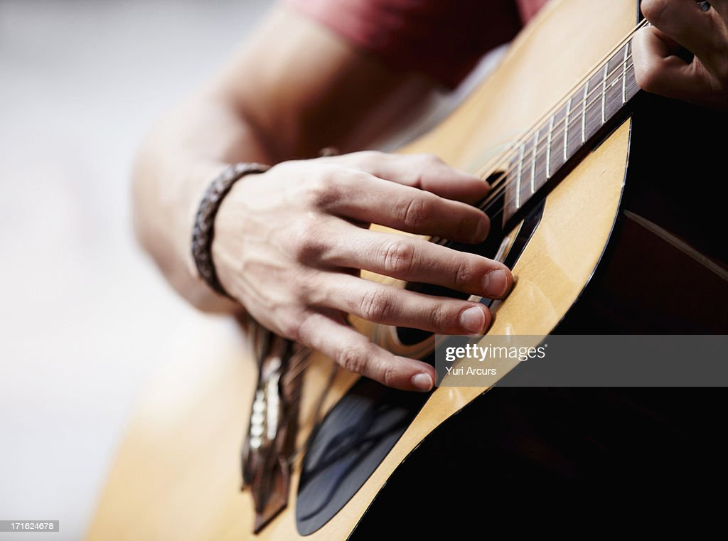 South Africa, Cape Town, Man playing guitar, close-up