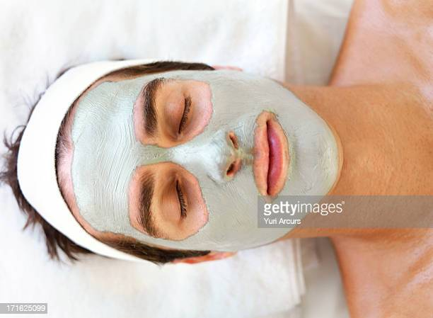 South Africa, Cape Town, Man with face mask relaxing in spa