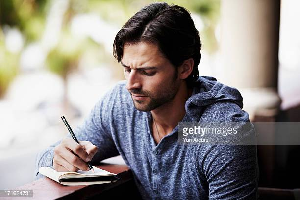 South Africa, Cape Town, Man writing diary