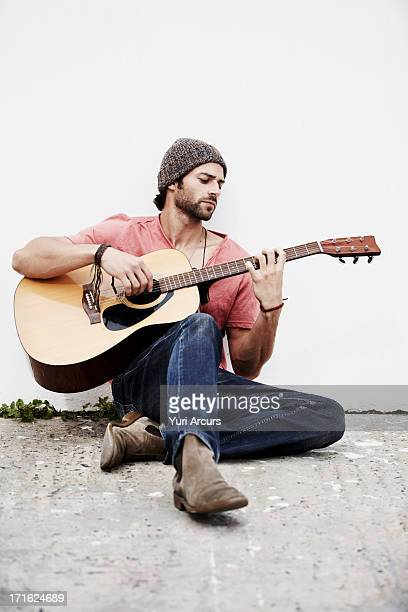 South Africa, Cape Town, Musician playing guitar outdoors
