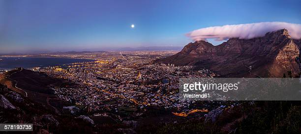 South Africa, Cape Town, panoramic view of cape town with signal hill and table mountain seen from lions head at full moon