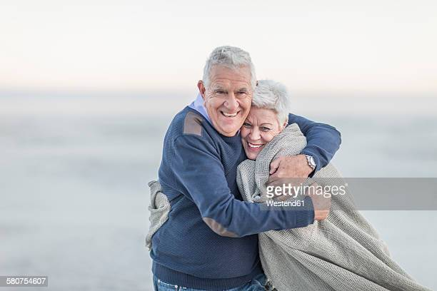 South Africa, Cape Town, portrait of senior couple on the beach