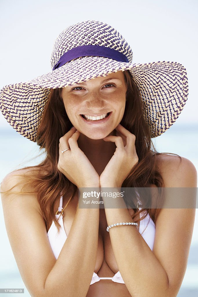 South Africa, Cape Town, Portrait of young woman in bikini and straw hat