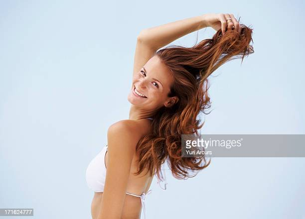 South Africa, Cape Town, Portrait of young woman in bikini with hand in hair
