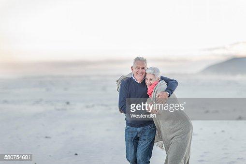 South Africa, Cape Town, senior couple on the beach