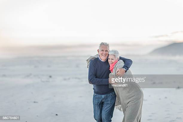 South Africa, Cape Town, senior couple on the beach