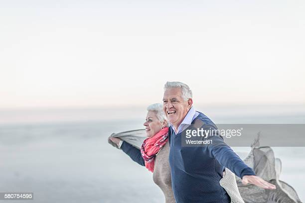 South Africa, Cape Town, senior couple relaxing on the beach