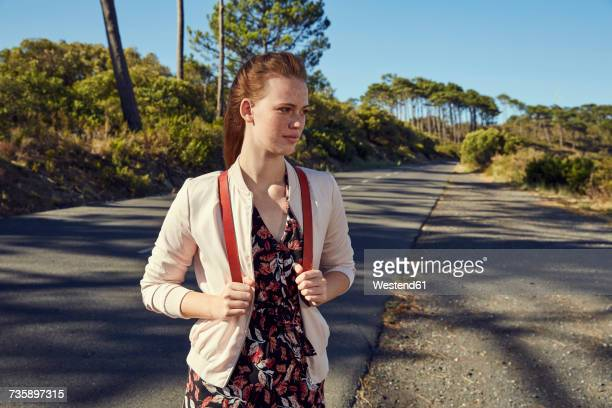 South Africa, Cape Town, Signal Hill, young woman on country road
