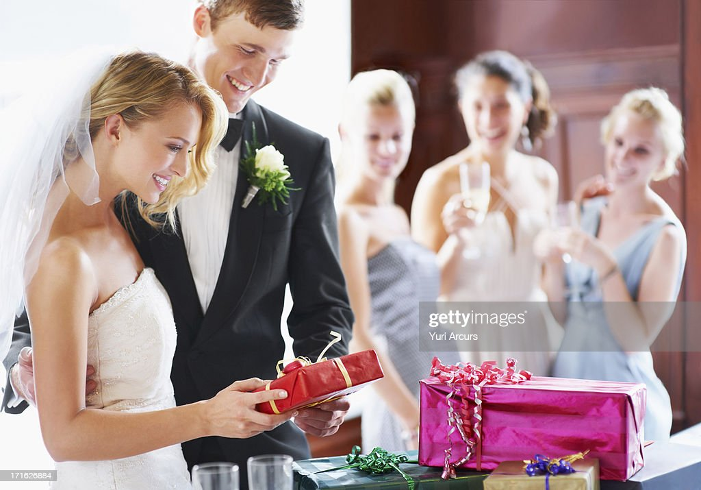 Wedding Gift List South Africa : Stock Photo : South Africa, Cape Town, Wedding couple opening gifts