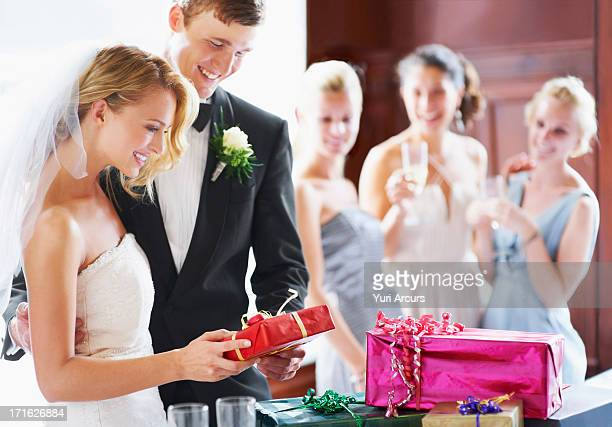 South Africa, Cape Town, Wedding couple opening gifts