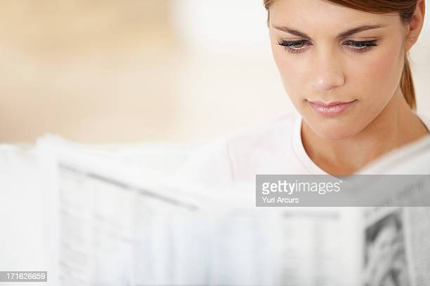 South Africa, Cape Town, Young woman reading newspaper