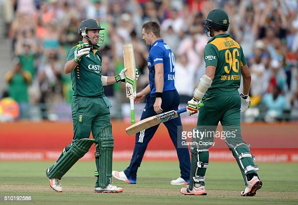 South Africa captain AB de Villiers and David Willey celebrates winning the 5th Momentum ODI match between South Africa and England at Newlands...